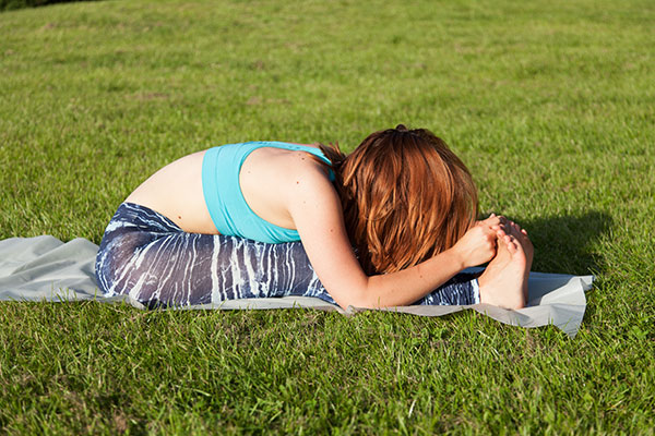 Yoga asana seated forward bend