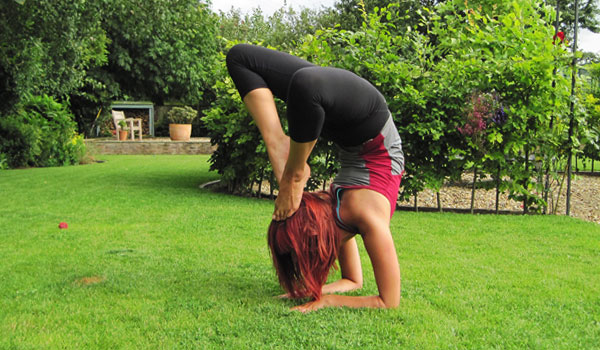 Yoga scorpion asana