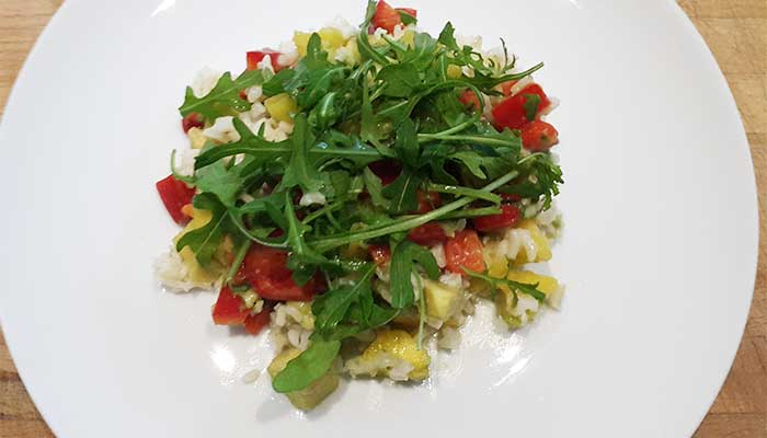 Coconut rice and rocket with mango and avocado salsa