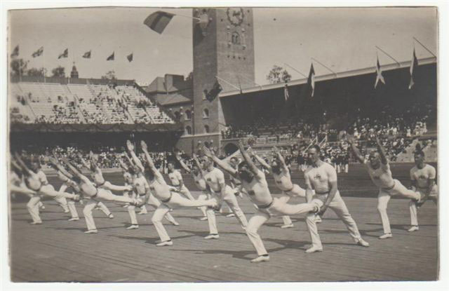 19th century Swedish gymnastics being performed at the Stockholm Olympics. Or are they coming into Warrior 3? Image source: From the article, The origins of yoga part III